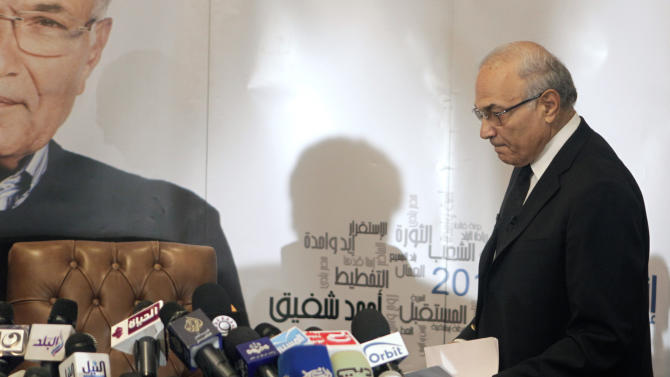Egyptian presidential candidate Ahmed Shafiq arrives to a press conference in Cairo, Egypt, Sunday, June 3, 2012. Shafiq, the last prime minister of deposed President Hosni Mubarak, will face the Muslim Brotherhood's candidate, Mohammed Morsi in a run-off on June 16-17. (AP Photo/Amr Nabil)