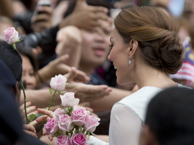 Kate, the Duchess of Cambridge meets well-wishers during a walk through a central city park in Kuala Lumpur, Malaysia, Friday, Sept. 14, 2012. (AP Photo/Mark Baker)
