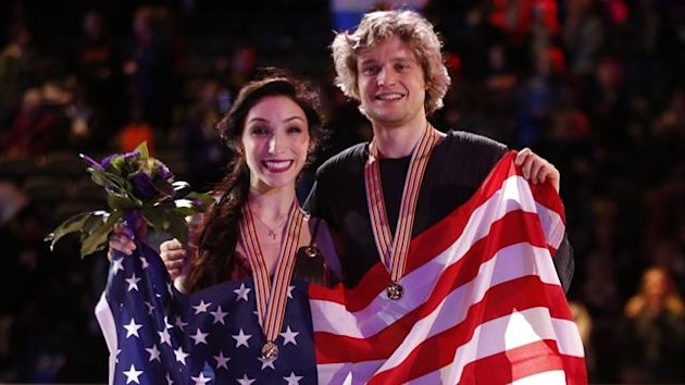 Gold medal winners Meryl Davis and Charlie White of the U.S. pose with their medals after the ice dance free dance