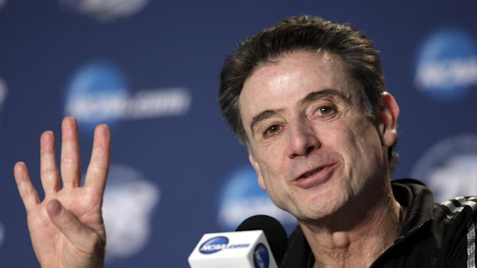 Louisville head coach Rick Pitino talks to reporters during a news conference, Saturday, March 30, 2013, in Indianapolis. Louisville is scheduled to play Duke in the Midwest Regional final in the NCAA college basketball tournament on Sunday. (AP Photo/Kiichiro Sato)