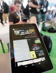 A Nexus 7 tablet is shown at the Google's developers conference on June 27. In addition to movie rentals, Google will be offering films for sale. The California-based Internet powerhouse boasted partnerships with major studios such as Disney, Paramount and Sony