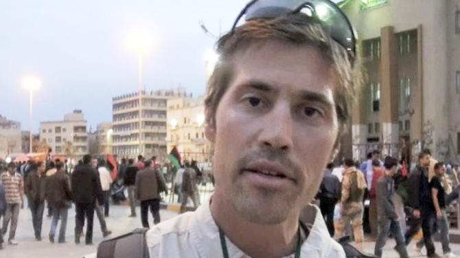 This undated file still image from video released April 7, 2011, by GlobalPost, shows James Foley of Rochester, N.H., a freelance contributor for GlobalPost, in Benghazi, Libya. A Libyan government spokesman says four journalists detained since early April have completed an administrative hearing and will be released Tuesday or Wednesday.(AP Photo/GlobalPost, File)