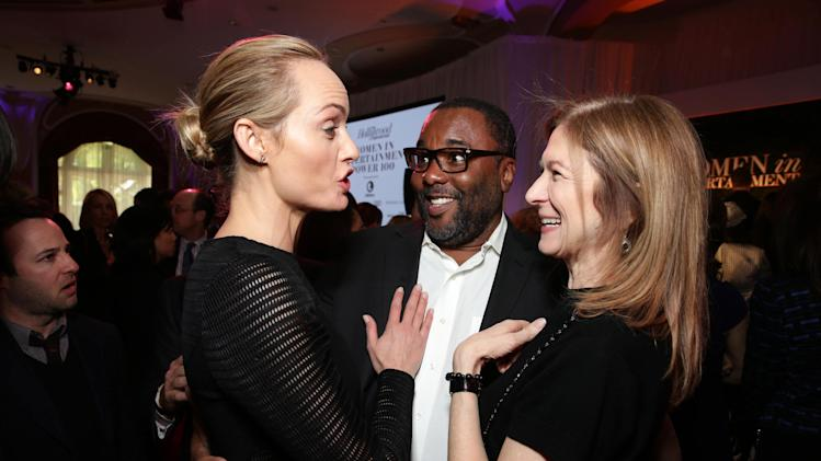 From Left, Taylor Schilling, Lee Daniels and Dawn Hudson attend THR's celebration of power 100 women in entertainment breakfast on Wednesday, Dec. 11, 2013 in Beverly Hills, Calif. (Photo by Eric Charbonneau/Invision for The Hollywood Reporter/AP Images)