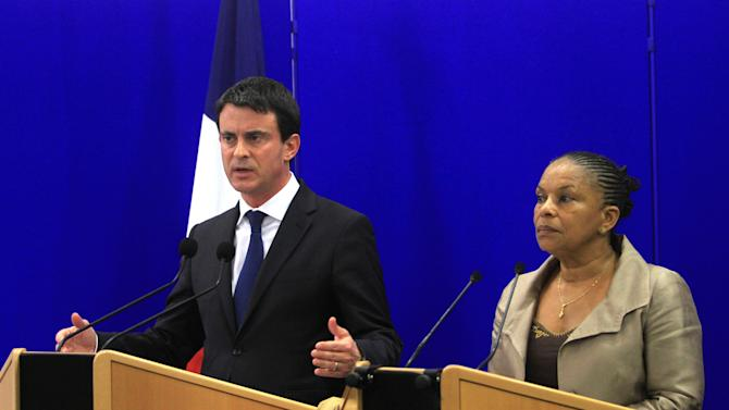 French Interior Minister Manuel Valls, left, and Justice Minister Christiane Taubira answer reporters questions during a press conference, in Ajaccio, Corsica island. France pledged Thursday to restore order in Corsica, a day after a prominent shopkeeper was killed on a busy street on the Mediterranean island long troubled by violent separatists and organized crime. The death of Jacques Nacer, who was also chief of Corsica's chamber of commerce, was the second high-profile killing on the island in a month. In October, a prominent defense lawyer was shot to death as he stopped for gas en route to work.  (AP Photo/Jean-Pierre Belzit)