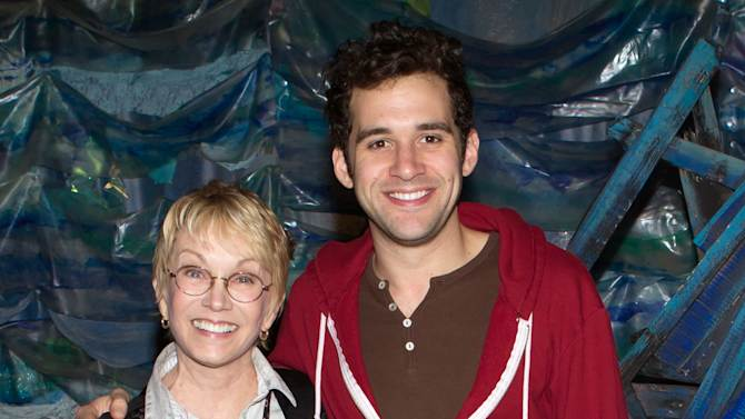 """This Oct. 14, 2012  image released by the O+M Company shows Cathy Rigby, left, with Adam Chanler-Berat backstage at the Broadway play """"Peter and the Starcatcher."""" Rigby, who has played Peter Pan for many year, came to lend her support to the latest Peter. (AP Photo/O+M Company, Tristan Fuge)"""