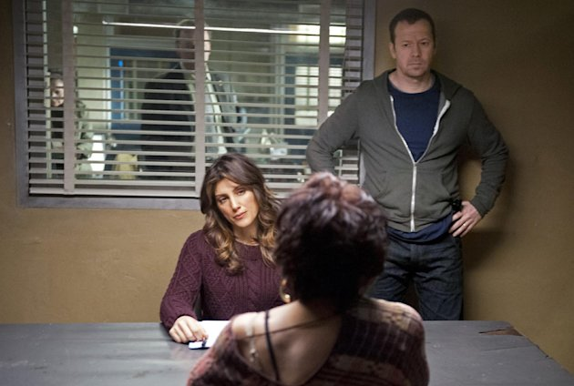 "This image released by CBS shows actress Jennifer Esposito, center, with co-star Donnie Wahlberg, in a scene from ""Blue Bloods."" Esposito is blasting CBS for sidelining her from the show. In Twitter postings, the actress has accused CBS of ""absolutely shameful behavior"" in putting her on unpaid leave from the Tom Selleck-starring police drama. Esposito tweeted that she's been diagnosed with celiac disease and requires a reduced work schedule. CBS has responded that because Esposito can't fulfill the full-time demands of her role, it has ""regretfully"" put her character, Detective Jackie Curatola, on a leave of absence. Her last appearance for now airs Nov. 2. The network says it hopes Esposito will be able to return. (AP Photo/CBS, JoJo Whilden)"