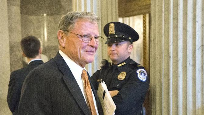 FILE - In this Feb. 14, 2013 file photo, Sen. James Inhofe, R-Okla. is seen on Capitol Hill in Washington. Inhofe is recovering in a Tulsa hospital after undergoing an emergency quadruple bypass last week. The Republican senator, who turns 79 next month, said doctors discovered the massive blockage in his arteries during a routine medical screening. He flew home to Tulsa and underwent the emergency heart surgery Friday at St. John Medical Center, the Tulsa World reported (AP Photo/J. Scott Applewhite, File)