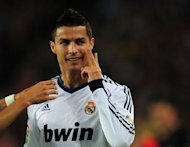 Real Madrid&#39;s Portuguese forward Cristiano Ronaldo celebrates after scoring a goal during the Spanish League Clasico football match FC Barcelona vs Real Madrid CF at the Camp Nou stadium in Barcelona. The match ended in a 2-2 draw