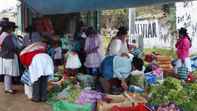 Andean women buy vegetables during a street fair in Pampacangallo town at Los Morochucos district, in Ayacucho