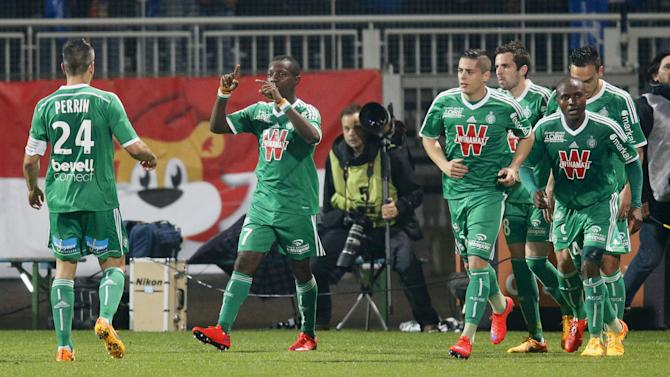 Gradel of Saint-Etienne reacts with teammates after scoring against Olympique Lyon during their French Ligue 1 soccer match in Lyon