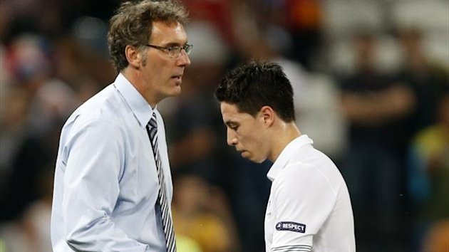 France's coach Laurent Blanc (L) shakes hands with Samir Nasri after their loss against Spain after their Euro 2012 quarter-final soccer match at Donbass Arena in Donetsk, June 23, 2012 (Reuters)