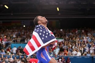 USA's Jordan Burroughs celebrates after defeating Iran's Sadegh Goudarzi in their men's 74kg freestyle gold medal match. Burroughs, the poster boy of American wrestling, lived up to all the pre-London 2012 hype by adding Olympic gold to his world title in the men's 74kg freestyle category. (AFP Photo/Marwan Naamani)