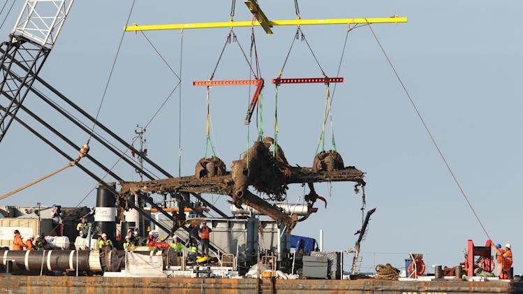 Lifting equipment raises a World War II Dornier bomber, the only surviving German Second World War Dornier Do 17 bomber, from the English Channel off Deal, southern England, Monday June 10, 2013. The aircraft was shot down off the Kent coast more than 70 years ago during the Battle of Britain and the project is believed to be the biggest recovery of its kind in British waters. Attempts by the RAF Museum to raise the relic over the last few weeks have been hit by strong winds but the operation was finally successful. (AP Photo/PA, Gareth Fuller) UNITED KINGDOM OUT NO SALES NO ARCHIVE