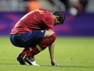 Spain&#39;s Alvaro Dominguez reacts after losing 1-0 to Honduras during the London 2012 Olympic Games men&#39;s football match Hondurtas against Spain at St James&#39; Park in Newcastle upon Tyne