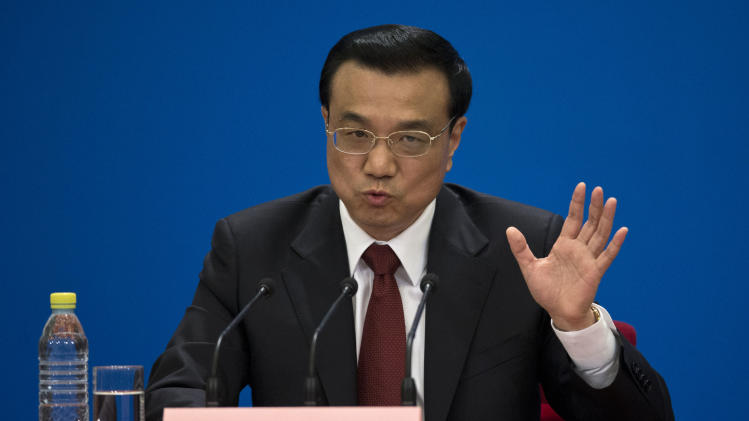 FILE - In this March 17, 2013 file photo, China's newly-named Premier Li Keqiang speaks during a press conference after the closing ceremony of the National People's Congress held in Beijing's Great Hall of the People.  Just weeks after a tense border standoff, China's new premier is heading to India on his first foreign trip as the neighboring giants look to expedite efforts to settle a decades-old boundary dispute and boost economic ties. China says Li's choice of India for his first trip abroad since taking office in March shows the importance Beijing attaches to improving relations with New Delhi. (AP Photo/Alexander F. Yuan, File)