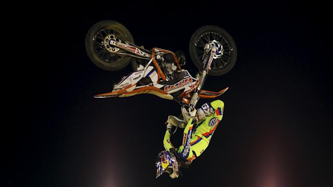 Spanish rider Torres performs a jump during the Malaga Freestyle motocross show at the Malagueta bullring in Malaga