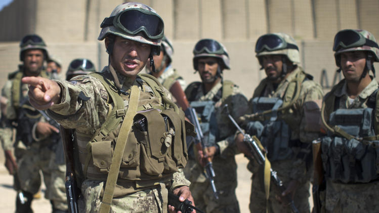 In this Friday, Oct. 19, 2012 photo, Col. Khalil Rahman, left, who commands 441 men in the 3rd Battalion of Afghanistan's elite Civil Order Police gives orders prior to a patrol in Marjah, southern Helmand province, Afghanistan. As the U.S. and NATO close out their mission in Afghanistan preparing for the final withdrawal of combat troops by the end of 2014, the worry looms large that fresh outbursts of ethnically motivated fighting would send the country into a spiral of chaos and violence. (AP Photo/Anja Niedringhaus)
