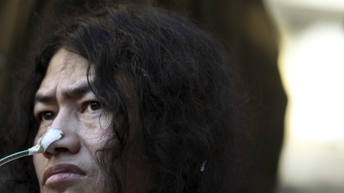 India's Irom Sharmila, who has been on a hunger strike for 12 years to protest an Indian law that suspends many human rights protections in areas of conflict, looks during a press conference, in New Delhi, India, Monday, March 4, 2013. Sharmila who has been force fed through a tube by authorities was charged Monday with attempted suicide in a case likely to bring major attention to her quiet protest in the tiny northeastern state of Manipur against the Armed Forces Special Powers Act. (AP Photo/Tsering Topgyal)