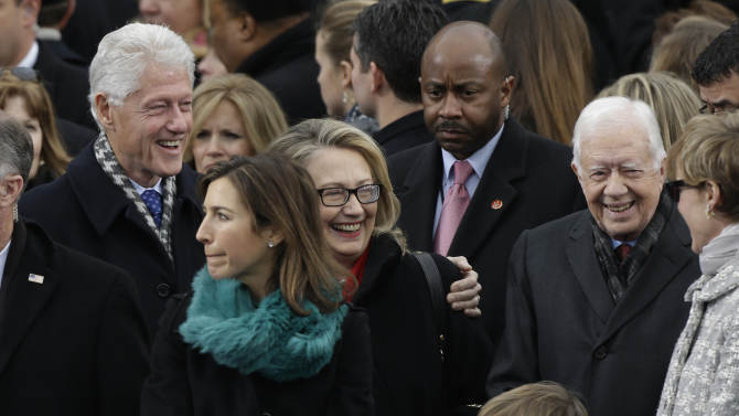 Secretary of State Hillary Clinton and former President Bill Clinton speak with former President Jimmy Carter at the ceremonial swearing-in for President Barack Obama at the U.S. Capitol during the 57th Presidential Inauguration in Washington, Monday, Jan. 21, 2013. (AP Photo/Pablo Martinez Monsivais)