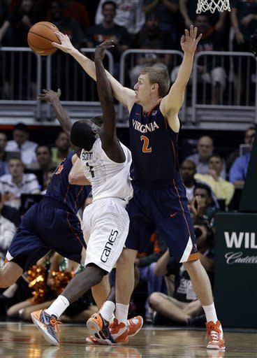 Johnson helps No. 2 Miami edge Virginia 54-50