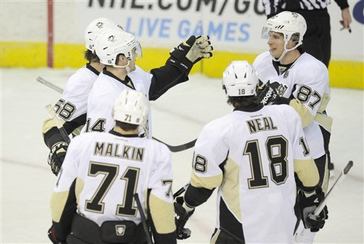 Pittsburgh Penguins left wing Chris Kunitz (14) celebrates his third goal of the game with teammates Sidney Crosby (87), Evgeni Malkin (71), of Russia, Kris Letang (58) and James Neal (18) during the third period of an NHL hockey game against the Washington Capitals, Sunday, Feb. 3, 2013, in Washington. The Penguins won 6-3. (AP Photo/Nick Wass)