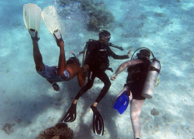 A guided tourist is seen with a trainer in Giftun island in Hurghada
