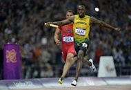 Jamaica's Usain Bolt crosses the finish line ahead of USA's Ryan Bailey in the men's 4x100m relay final at the athletics event of the London 2012 Olympic Games