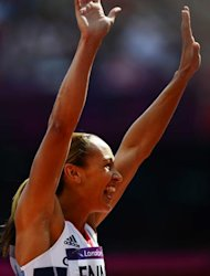 Britain&#39;s Jessica Ennis reacts after competing in the women&#39;s heptathlon 100m hurdles heats at the athletics event during the London 2012 Olympic Games on August 3, 2012 in London.   AFP PHOTO / OLIVIER MORIN