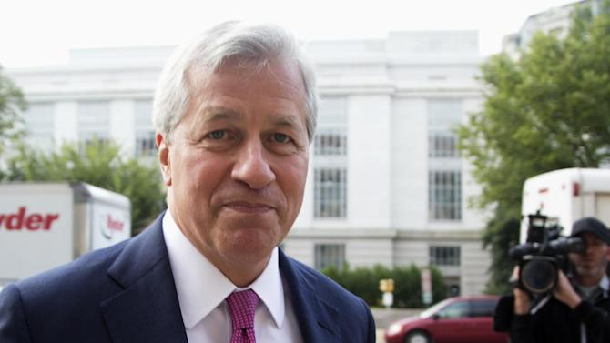 FILE - In this Sept. 26, 2013 file photo JPMorgan Chase Chairman, President and Chief Executive Officer Jamie Dimon, arrives at the Department of Justice in Washington. Morgan Chase almost doubled Chairman and CEO Jamie Dimon's pay for 2013, the bank said on Friday, Jan. 24, 2014 that Dimon will receive total compensation of $20 million in 2013, consisting of $18.5 million in stock options and a base salary of $1.5 million. (AP Photo/Manuel Balce Ceneta, File)