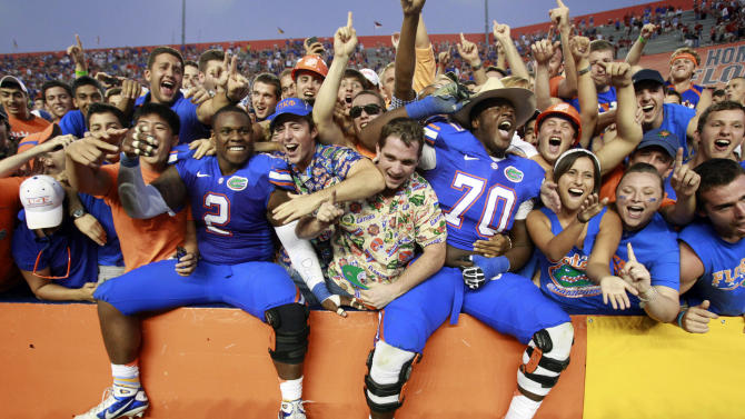 Florida's Dominique Easley (2) and D.J. Humphries (70) celebrate with fans after defeating South Carolina 44-11 in an NCAA college football game, Saturday, Oct. 20, 2012, in Gainesville, Fla.(AP Photo/John Raoux)