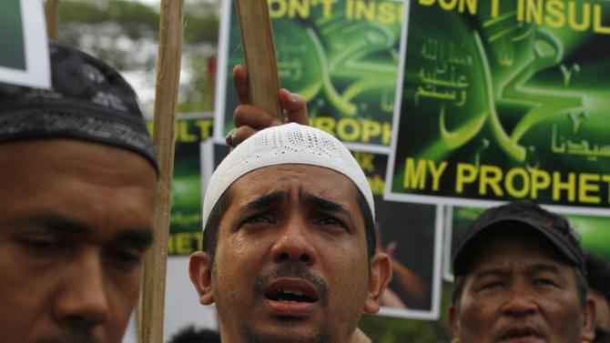 "Indonesian Muslims shout slogans as they hold banners reading ""Don't insult my Prophet Muhammad"" during a protest against an anti-Islam film that has sparked anger among followers, outside the U.S. Embassy in Jakarta, Indonesia, Friday, Sept. 21, 2012. The U.S. has closed its diplomatic missions across Indonesia due to continuing demonstrations over the American-produced film ""Innocence of Muslims,"" which denigrates the Prophet Muhammad. (AP Photo/Achmad Ibrahim)"