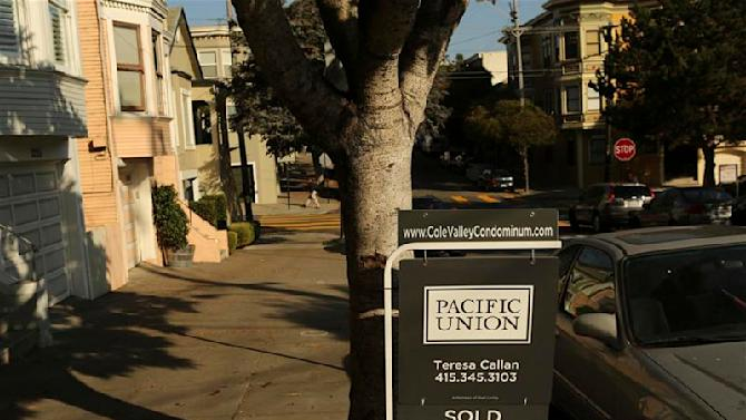 A sign for a sold condominium hangs in the Cole Valley neighborhood in San Francisco