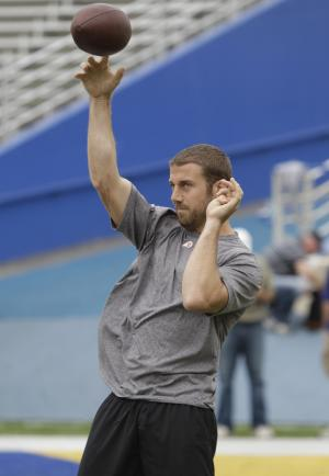 San Francisco 49ers quarterback Alex Smith, who is a free agent, tosses a pass during an informal mini-camp he helped organize during the NFL football lockout at San Jose State University in San Jose, Calif., Tuesday, June 28, 2011. (AP Photo/Paul Sakuma)