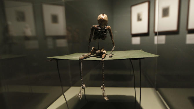 A sculpture 'Gentleman on Green Table' by U.S. artist June Leaf is seen on display at an exhibition 'Death : The Richard Harris Collection' at the Wellcome Collection gallery in London, Wednesday, Nov. 14, 2012. (AP Photo/Sang Tan)