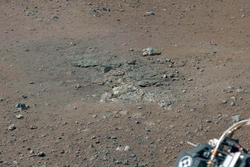 This image released on Friday Aug. 17,2012 shows bedrocks that was exposed after Curiosity's rocket stage fired its engines that blew away soil from the Martian surface. The Mars rover is preparing to aim its laser next week at a rock in the first test of the instrument. (AP Photo/NASA)