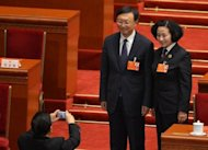 <p>The outgoing Chinese Foreign Minister Yang Jiechi (left) poses for a photo during the 12th National People's Congress (NPC) in the Great Hall of the People in Beijing, on March 16, 2013.</p>