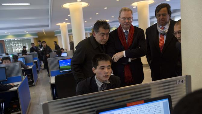Executive Chairman of Google, Eric Schmidt, third from left, and former New Mexico governor Bill Richardson, second from right, watch as a North Korean student surfs the Internet at a computer lab during a tour of Kim Il Sung University in Pyongyang, North Korea on Tuesday, Jan. 8, 2013. Schmidt is the highest-profile U.S. executive to visit North Korea - a country with notoriously restrictive online policies - since young leader Kim Jong Un took power a year ago. (AP Photo/David Guttenfelder)