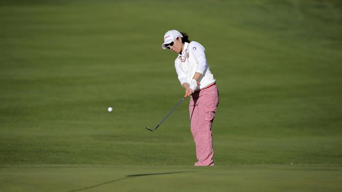 Miyazato leads Evian, with Ko a stroke back