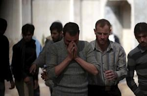 A man reacts as he mourns the death of his relative…