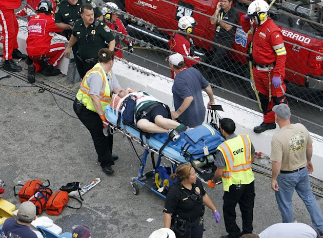 An injured spectator is treated after a crash at the conclusion of the NASCAR Nationwide Series auto race Saturday, Feb. 23, 2013, at Daytona International Speedway in Daytona Beach, Fla. Driver Kyle