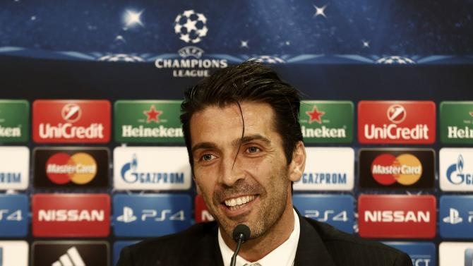 Juventus' goalkeeper Buffon smiles during a news conference on the eve of their Champions League soccer match against Olympiakos in Piraeus near Athens