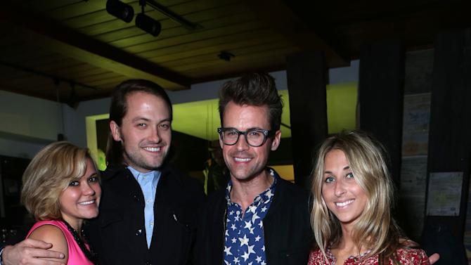 """Lindsay Myers, Thomas Phillips, Brad Goeski and Hannah Soboroff at Brad Goeski dinner at Levi's Haus for """"It's a Brad Brad World"""", on Tuesday, March, 19, 2013 in Los Angeles. (Photo by Alexandra Wyman /Invision for Levi's/AP Images)"""