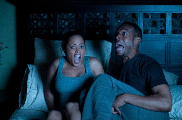 "This film image released by Open Road Films shows Essence Atkins, left, and Marlon Wayans in a scene from ""A Haunted House."" (AP Photo/Open Road Films, Will McGarry)"