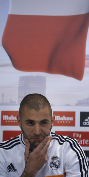 Real Madrid's Karim Benzema from France gesture during a news conference to discuss the draw for the 2014 World Cup at the Valdebebas training grounds, outside Madrid