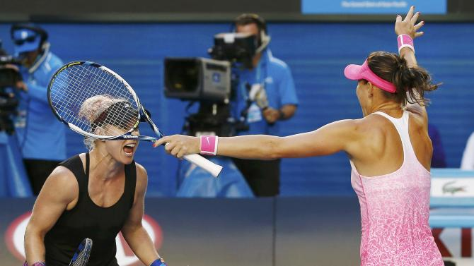 Mattek-Sands of the U.S. and Safarova of Czech Republic celebrate defeating Zheng of China and Chan of Taiwan to win their women's doubles final match at the Australian Open tennis tournament in Melbourne