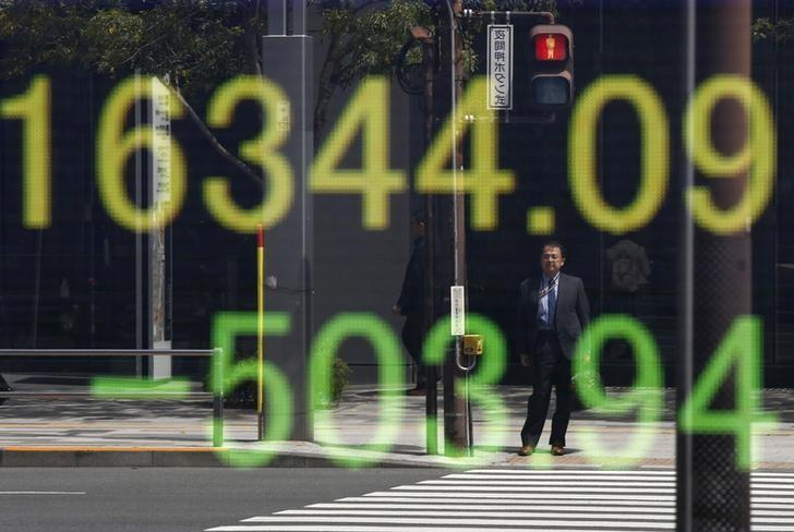 Asia shares firm but set for monthly loss