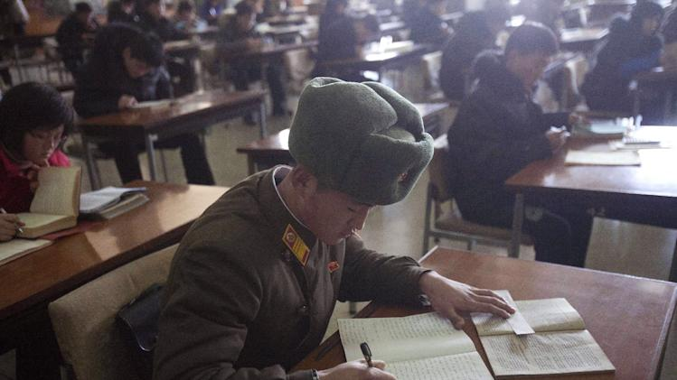 A North Korean soldier attends a class at the Grand Peoples Study House in Pyongyang, North Korea on Wednesday, Jan. 9, 2013. (AP Photo/David Guttenfelder)