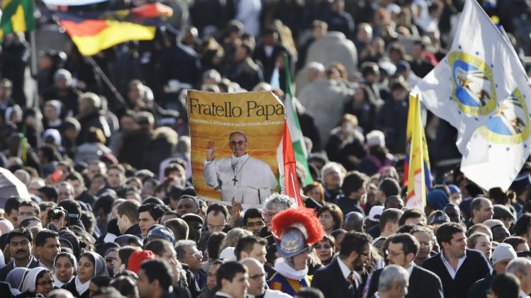 Crowds gather in St. Peter's Square for the inauguration of Pope Francis at the Vatican, Tuesday, March 19, 2013. (AP Photo/Gregorio Borgia)