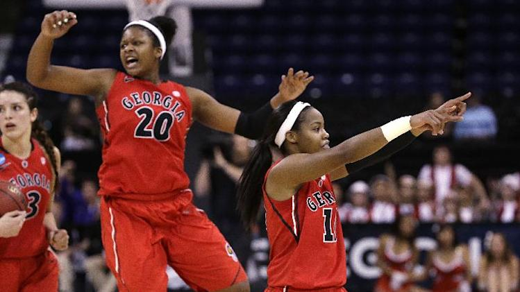 Georgia's Jasmine James, right, motions to fans as Shacobia Barbee (20) celebrates in the final seconds against Stanford in a regional semifinal in the NCAA women's college basketball tournament Saturday, March 30, 2013, in Spokane, Wash. Georgia won 61-59. (AP Photo/Elaine Thompson)