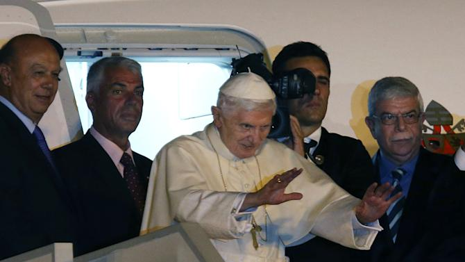 "Pope Benedict XVI waves as he boards the plane back to Rome, at Rafik Hariri International airport, in Beirut, Lebanon, Sunday Sept. 16, 2012. Pope Benedict XVI end his three days visit to Lebanon after he celebrated an open-air mass for tens of thousands of pilgrims from across the Middle East, saying Christians must do their part to end the ""grim trail of death and destruction"" in the region. (AP Photo/Hussein Malla)"